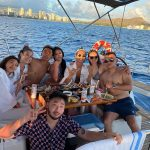 Tourist on a Sailing boat having dinner party in Honolulu