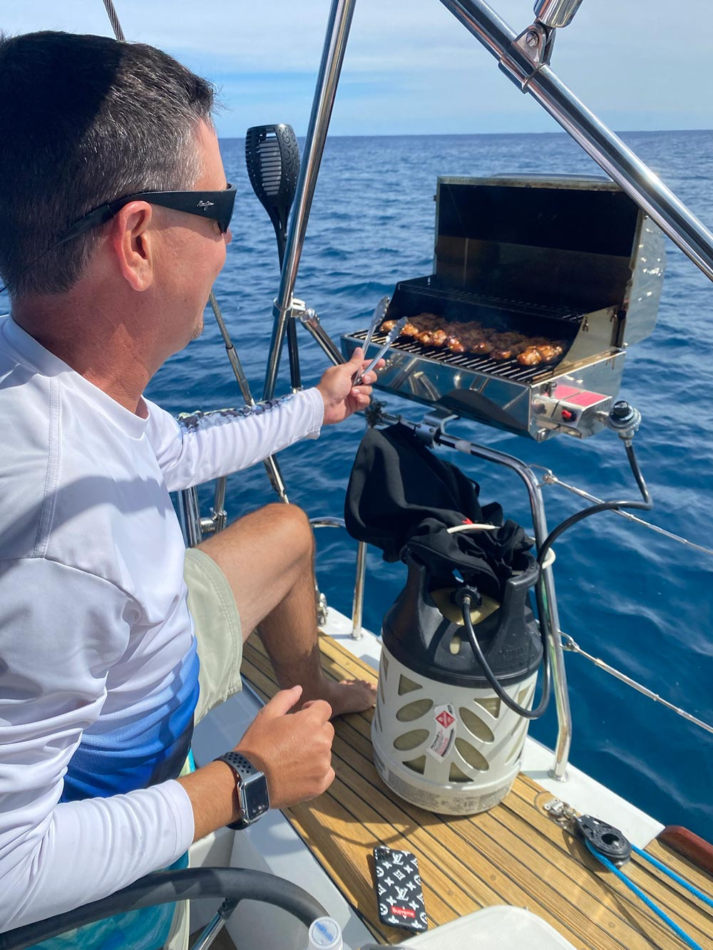 Man bbq on sailing yacht in Honolulu