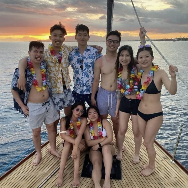 Group of tourist on a boat - rent a yacht for birthday party