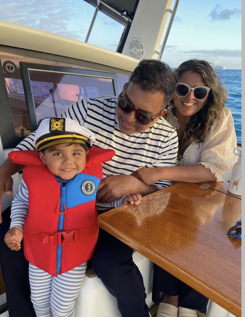 Couple and kid at private sailboat cruise on Oahu