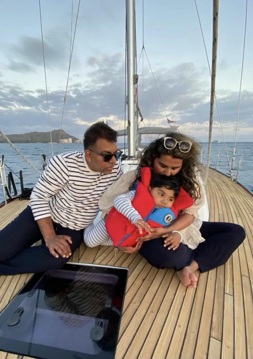 Couple and kid at sailing cruise in Waikiki
