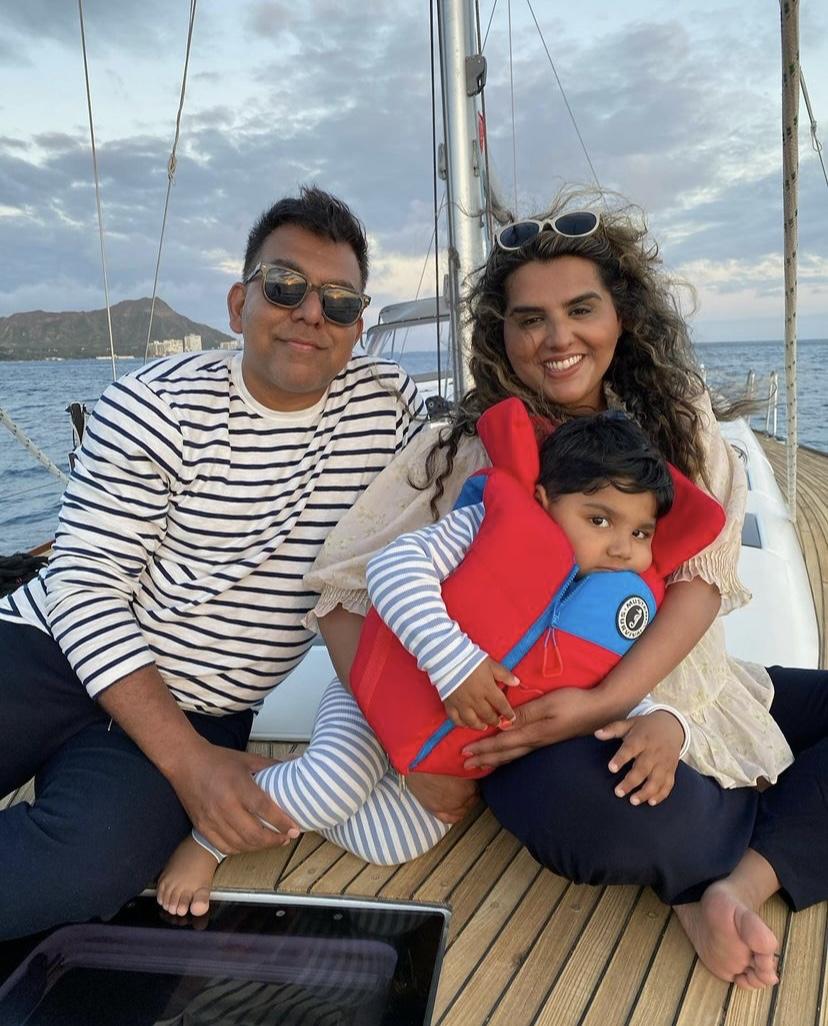 Couple and kid at sailing cruise in Hawaii