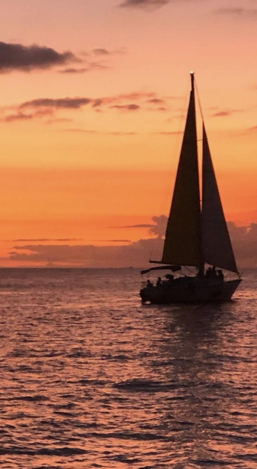 sailboat into sunset hawaii