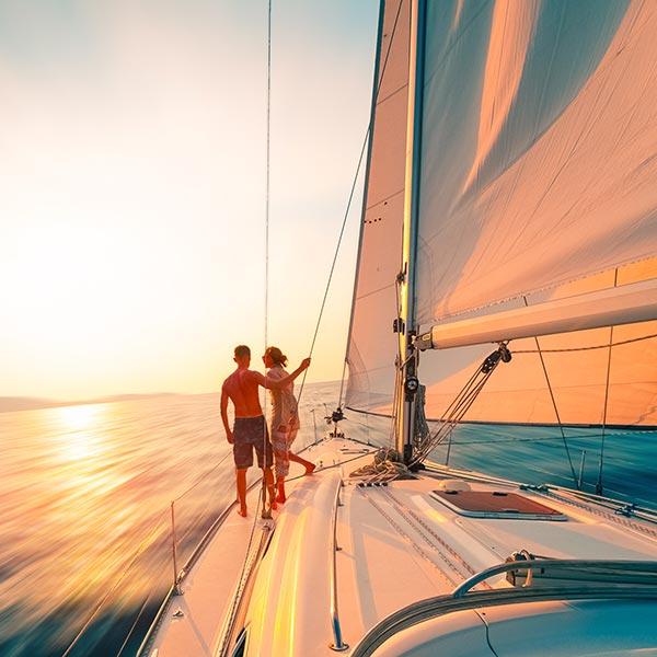 boat and couple sunset cruise oahu