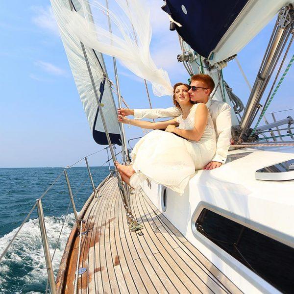 wedding couple on sail boat